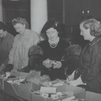H.M. Queen Elizabeth, the Queen Mother (1900-2002) president of British Red Cross visits a Red Cross care package centre