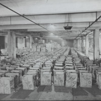 Boxes  in a warehouse with cloth covers with Red Cross emblem