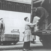 Delivery of boxes from a truck [English Registration Plate AXX 943]